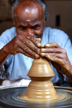 Indian Potter Making a Pot photo