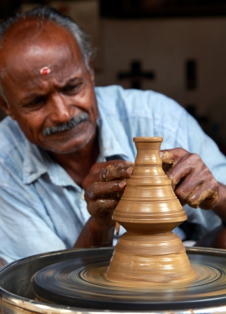 Indian Potter Making a New Pot photo