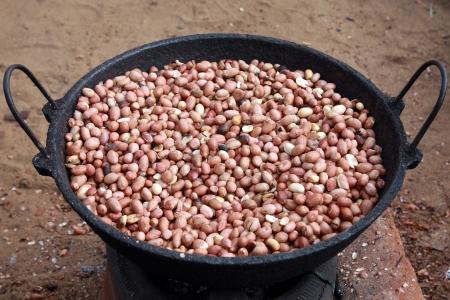 goober peas: Peanuts being roasted on a tawa