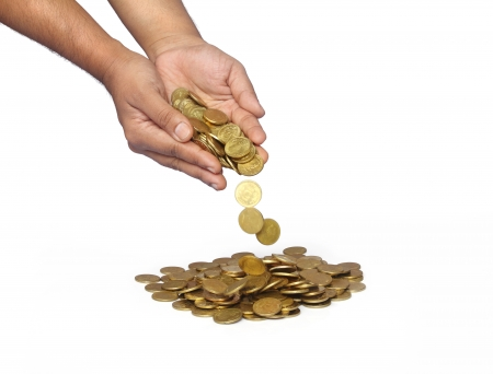 Man Hands Droping the Gold Coins