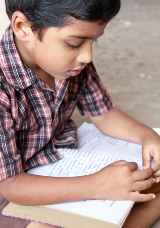 traditionally indian: Indian Village Boy Reading the Book
