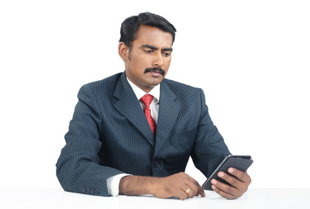 Indian Businessman with Cellphone