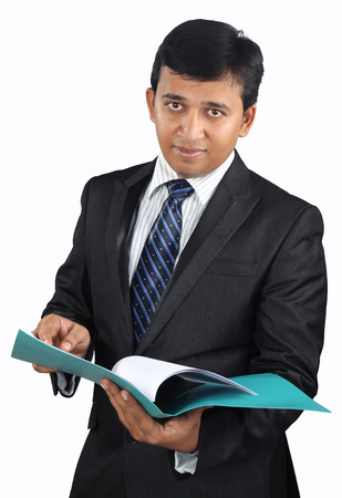 joyful businessman: Indian businessman checking the documents