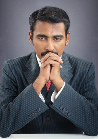 indian young businessman praying Banque d'images