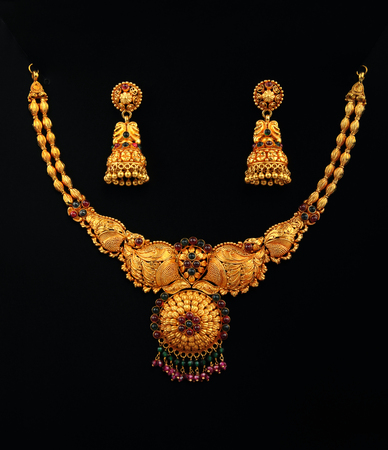 fashion jewellery: Indian Traditional Gold Necklace With Earrings Stock Photo