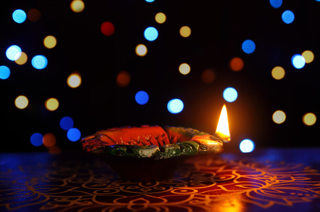 oillamp: Indian Traditional kolam with Oil Lamp