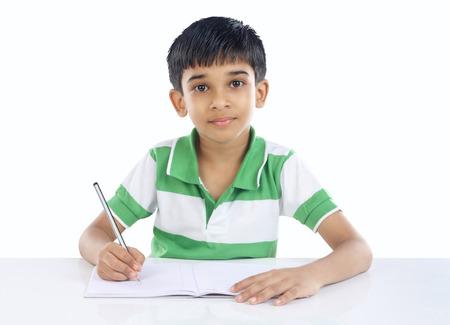 lapiz: Indian School Boy presenta a la c�mara Foto de archivo