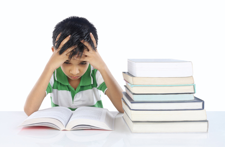 child reading book: Depressed School boy