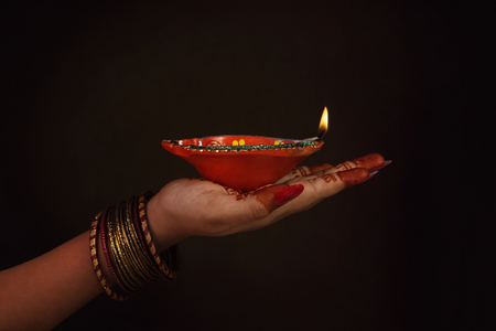 Indian Girl Holding Traditional Oil Lamp