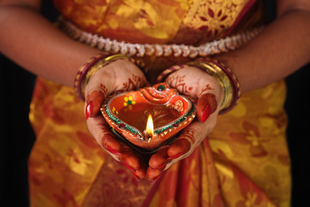 tamilnadu: Indian Girl Holding Traditional Oil Lamp