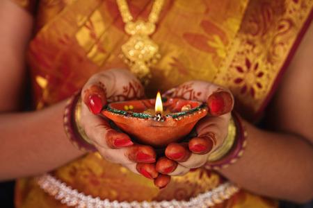 Indian girl holding Oil Lamp
