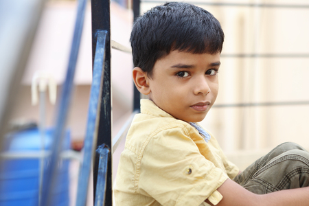 indian style sitting: Portrait of Indian Little Boy Stock Photo