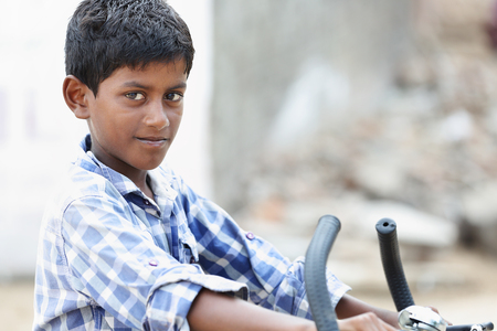 Portrait of Indian Young Boy with bicycle Stock Photo