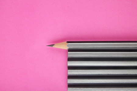 Pencil isolated on pink background