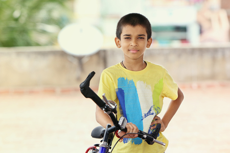 Portrait of Indian Boy with Bicycle
