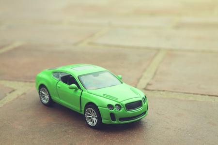 automobile door: A toy car on the floor.