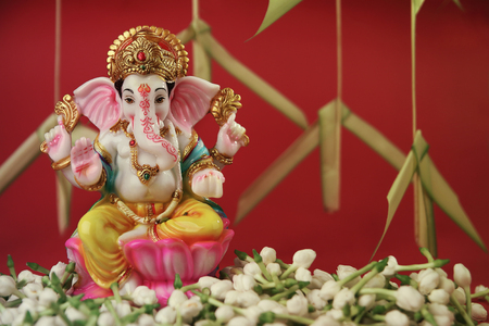 Hindu God Ganesha with jasmine flowers