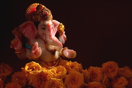 Hindu God Ganesha with Rose Flowers