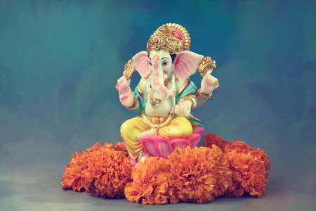 Hindu God Ganesha with  marigold flowers