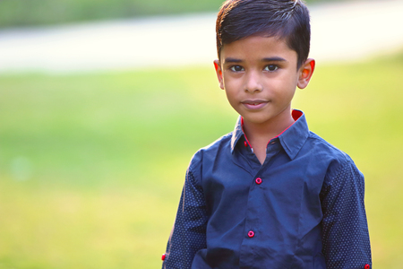 Portrait of Indian Little Boy Posing to Camera with Expression Stock Photo - 117869427