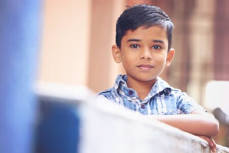 Portrait of Indian Little boy Posing to Camera with Cheerful Expression Stock Photo
