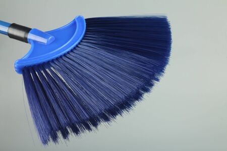 Plastic broom stick isolated on gray background