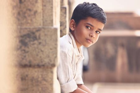 Portrait of Indian Boy Posing to Camera Stock Photo - 129496916