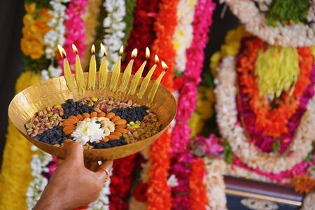 Indian Traditional Pooja with garlands decoration Stock Photo