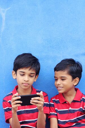 Indian Cute Little Boy With Cellphone