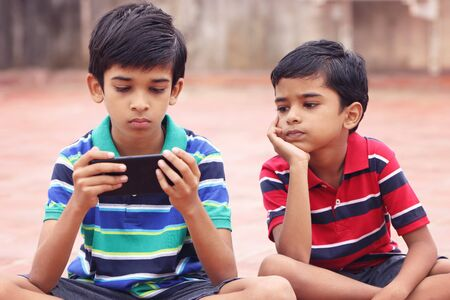 Indian Little Brothers with MobilePhone