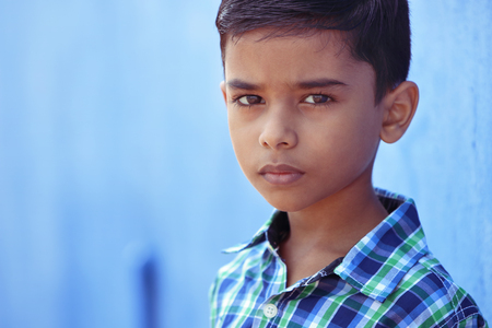 Portrait of Indian Little boy Posing to Camera with Expression Stock Photo - 121493840