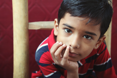 Portrait of Indian Little boy Posing to Camera with Cute Expression Stock Photo