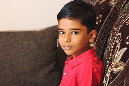 Portrait of indian boy posing to camera Stock Photo