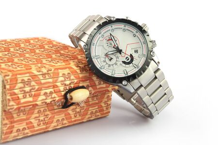 Men's wrist metal watch on white background with gift box