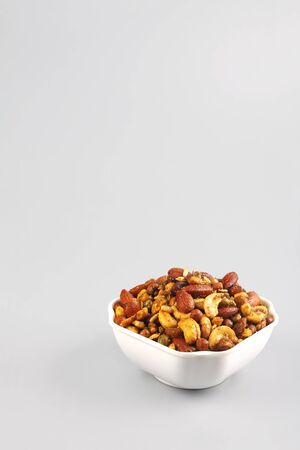 Indian traditional snack mixture with cashew nut and almond Stockfoto