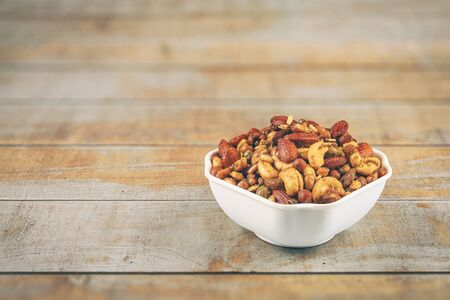Indian traditional snack mixture with cashew nut and almond Standard-Bild