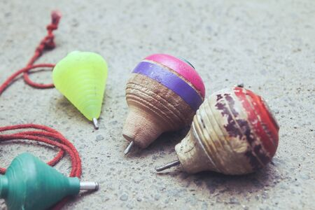 Classic wooden spinning top toy with string