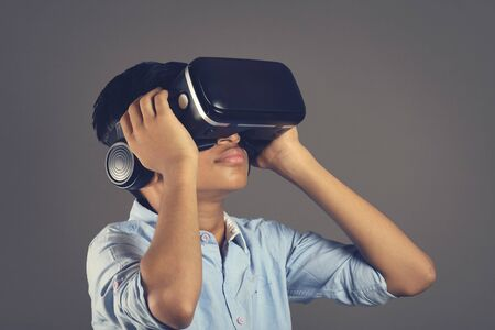 Portrait of Indian young boy wearing Virtual Reality Glasses