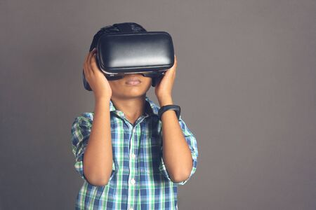 Portrait of Indian little boy wearing Virtual Reality Glasses