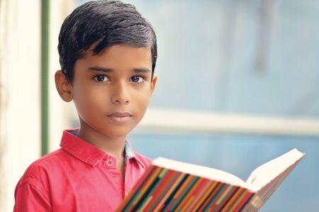 Portrait of Indian little school boy posing to camera