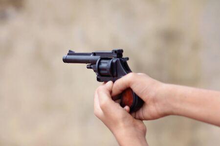 Little boy holding the toy gun Stock Photo