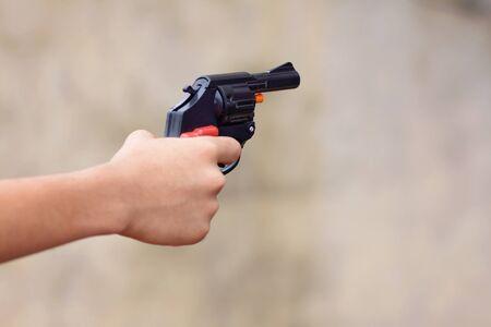 Little boy holding the toy gun