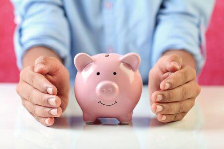 Boy holding piggy bank for savings