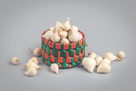 Indian traditional single clove garlics in basket