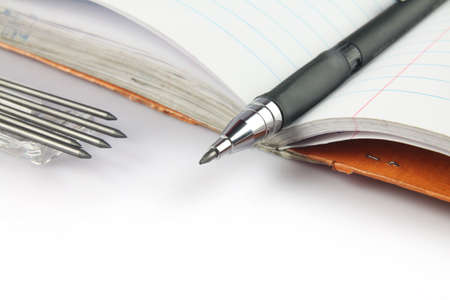 Mechanical pencil with leads on notebook Stock Photo