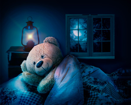 teddy bear in bed. sleep at night 版權商用圖片
