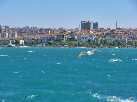 View from Istanbul coast with sea and buildings photo