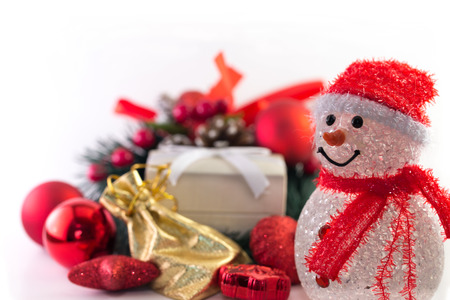Snowman with christmas decorations and gift box.