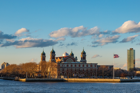 Ellis island from side view in open cloudy sky. Editorial