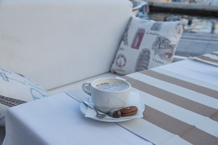 couching: Coffee on the table near the seaside.